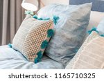 decorative cozy pillows on a... | Shutterstock . vector #1165710325