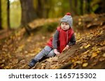 little boy gets injured during... | Shutterstock . vector #1165715302
