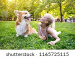 beautiful fun blond girl and... | Shutterstock . vector #1165725115