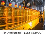 sunflower oil. factory line of... | Shutterstock . vector #1165733902