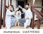 front porch. smiling beaming... | Shutterstock . vector #1165745302