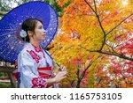 asian woman wearing japanese... | Shutterstock . vector #1165753105