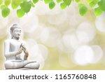 stone statue of buddha and...   Shutterstock . vector #1165760848