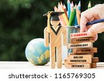 blur hand placing student wood... | Shutterstock . vector #1165769305
