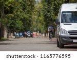 white passenger medium size... | Shutterstock . vector #1165776595