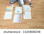 businesswoman in office in... | Shutterstock . vector #1165808248