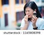 reaction of young woman with... | Shutterstock . vector #1165808398