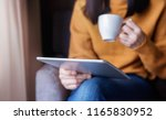 reading concept. young woman... | Shutterstock . vector #1165830952