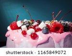 fruit yoghurt cake on a blue... | Shutterstock . vector #1165849072