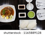 top view a white plate of...   Shutterstock . vector #1165889128