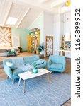 fashionable spacious apartment... | Shutterstock . vector #1165899952