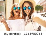 two young female smiling hippie ... | Shutterstock . vector #1165900765