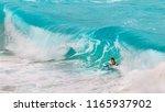 Small photo of Honolulu, Hawaii - August 26, 2018: Located on Oahu's east shore, Makapuu Beach Park is arguably the island's best bodysurf and bodyboard spot.