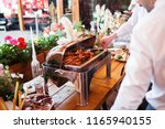 waiters serve shrimp  catering... | Shutterstock . vector #1165940155