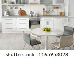 stylish kitchen interior with... | Shutterstock . vector #1165953028