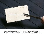 philately concept   tongs keeps ... | Shutterstock . vector #1165959058