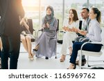 human rights seminar with... | Shutterstock . vector #1165969762