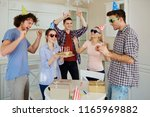 friends with cake celebrating... | Shutterstock . vector #1165969882