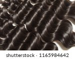 loose deep curly black human... | Shutterstock . vector #1165984642
