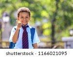 cute african american schoolboy ... | Shutterstock . vector #1166021095