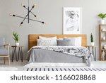 patterned blanket on wooden bed ... | Shutterstock . vector #1166028868