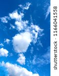 blue sky with white clouds.... | Shutterstock . vector #1166041558