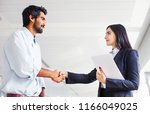 indian woman and man wearing... | Shutterstock . vector #1166049025