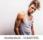 attractive man wearing t shirt. | Shutterstock . vector #116607352