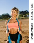 fit cheerful woman posing at...   Shutterstock . vector #1166077438