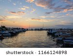 sunset picture of anchored... | Shutterstock . vector #1166124898