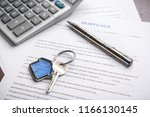 key with trinket  pen and... | Shutterstock . vector #1166130145