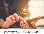woman hand using smartphone... | Shutterstock . vector #1166136358