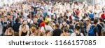 large crowd of people at rush... | Shutterstock . vector #1166157085
