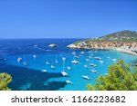 cala d'hort bay with beach and... | Shutterstock . vector #1166223682