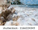 action shot of a spiralling... | Shutterstock . vector #1166224345