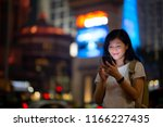 young woman use smartphone on... | Shutterstock . vector #1166227435