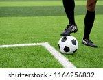 the foot of the footballer... | Shutterstock . vector #1166256832