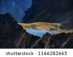 deep into the mountains. chalet ... | Shutterstock . vector #1166282665