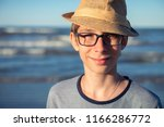young boy posing in hat at the... | Shutterstock . vector #1166286772