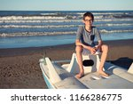 young boy sitting on catamaran... | Shutterstock . vector #1166286775