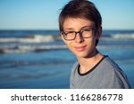 young boy posing at the summer... | Shutterstock . vector #1166286778