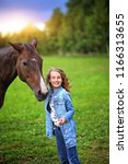 young girl with a horse | Shutterstock . vector #1166313655