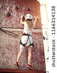 climbing on a rope park | Shutterstock . vector #1166314138