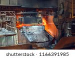smelting of the metal in the... | Shutterstock . vector #1166391985