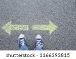 man standing on road near... | Shutterstock . vector #1166393815
