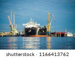 close up of the cargo ship in... | Shutterstock . vector #1166413762