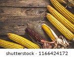 autumn fruit with corn on wood. ...   Shutterstock . vector #1166424172