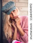 beautiful woman in flat cap and ... | Shutterstock . vector #1166434492