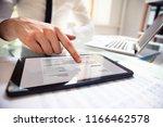 close up of a businessperson's... | Shutterstock . vector #1166462578
