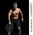 strong man working out with... | Shutterstock . vector #1166483872